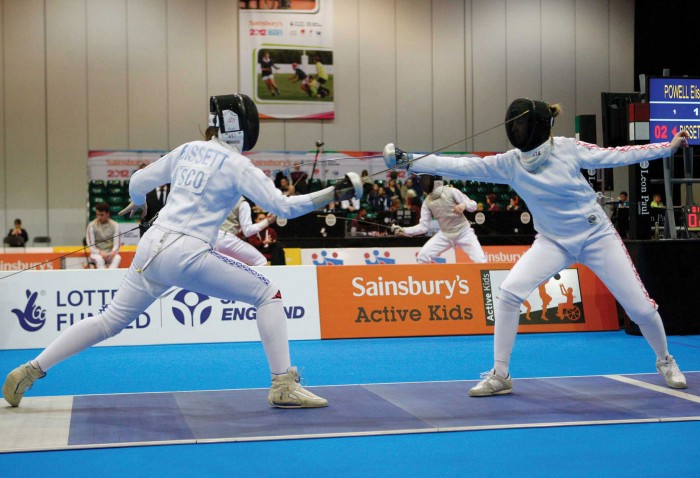 Event Graphics by Octink behind two competitive fencers