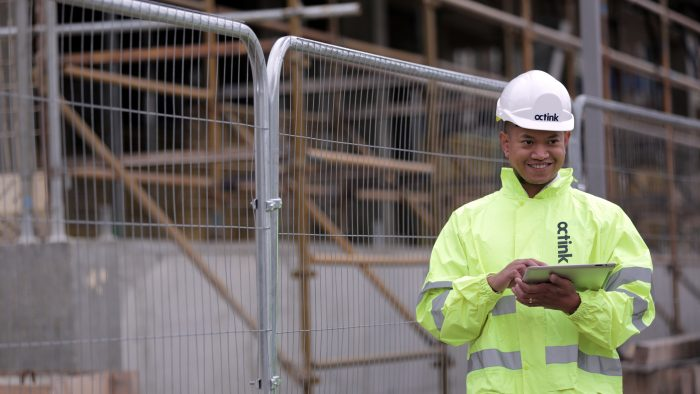 A site worker smiling whilst using Print Guardian, by Octink