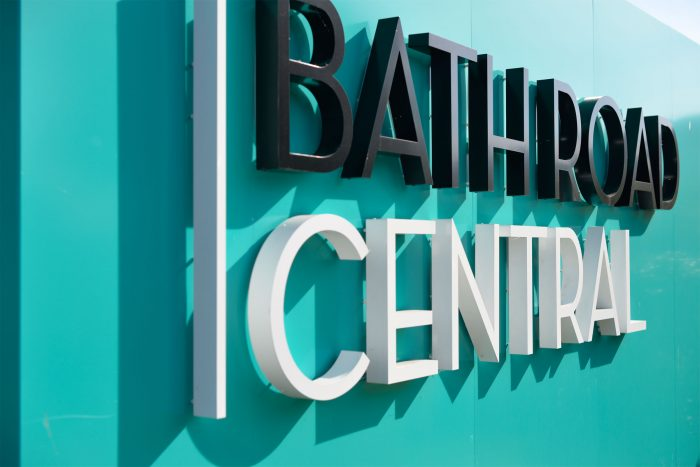 A blue hoarding with 3D letters for Bath Road Central, created and installed by Octink