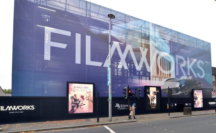 Image shows giant printed mesh building wrap and site hoarding graphics for St George at Filmworks. Production and installation by Octink.