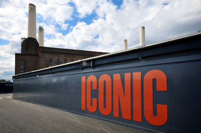 Image shows part of the branded advertising hoarding featuring giant fret-cut sprayed letters at the Battersea Power Station Development. Production and installation.