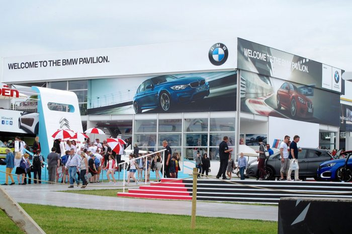 Image shows giant printed building wrap of the BMW Pavilion at the Goodwood Festival of Speed. Production and installation by Octink.