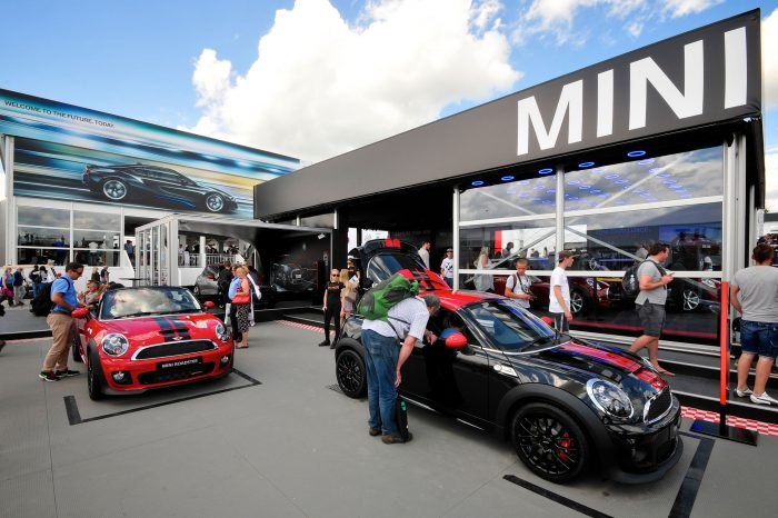 Image shows giant printed building wrap for Mini at the Goodwood Festival of Speed. Production and installation by Octink.