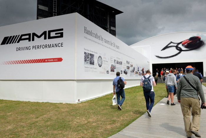 Image shows giant printed building wrap celebrating 50 years performance racing by Mercedes at the Goodwood Festival of Speed. Production and installation by Octink.
