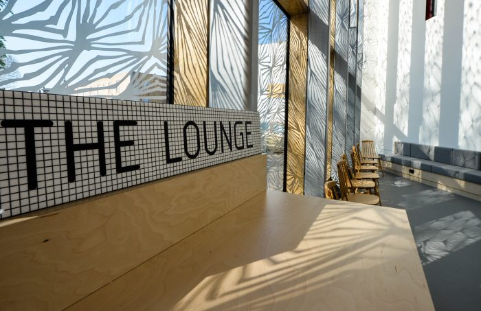 A Lounge with window vinyl and display signage