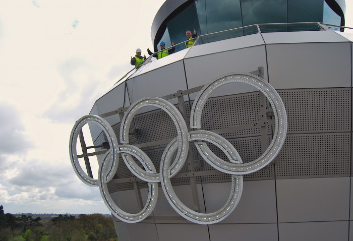 Workers finish installing the Olympic Rings