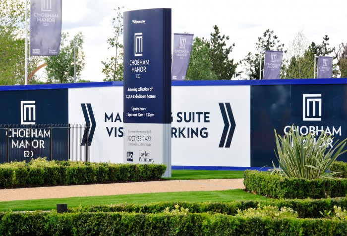 Chobham manor hoarding with directional signage and free standing totem