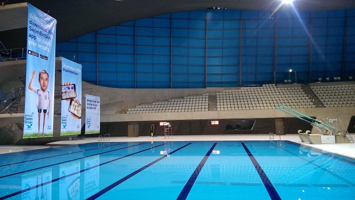 Branded hanging banners & event signage for SwimBritain Aquatic Centre by Octink