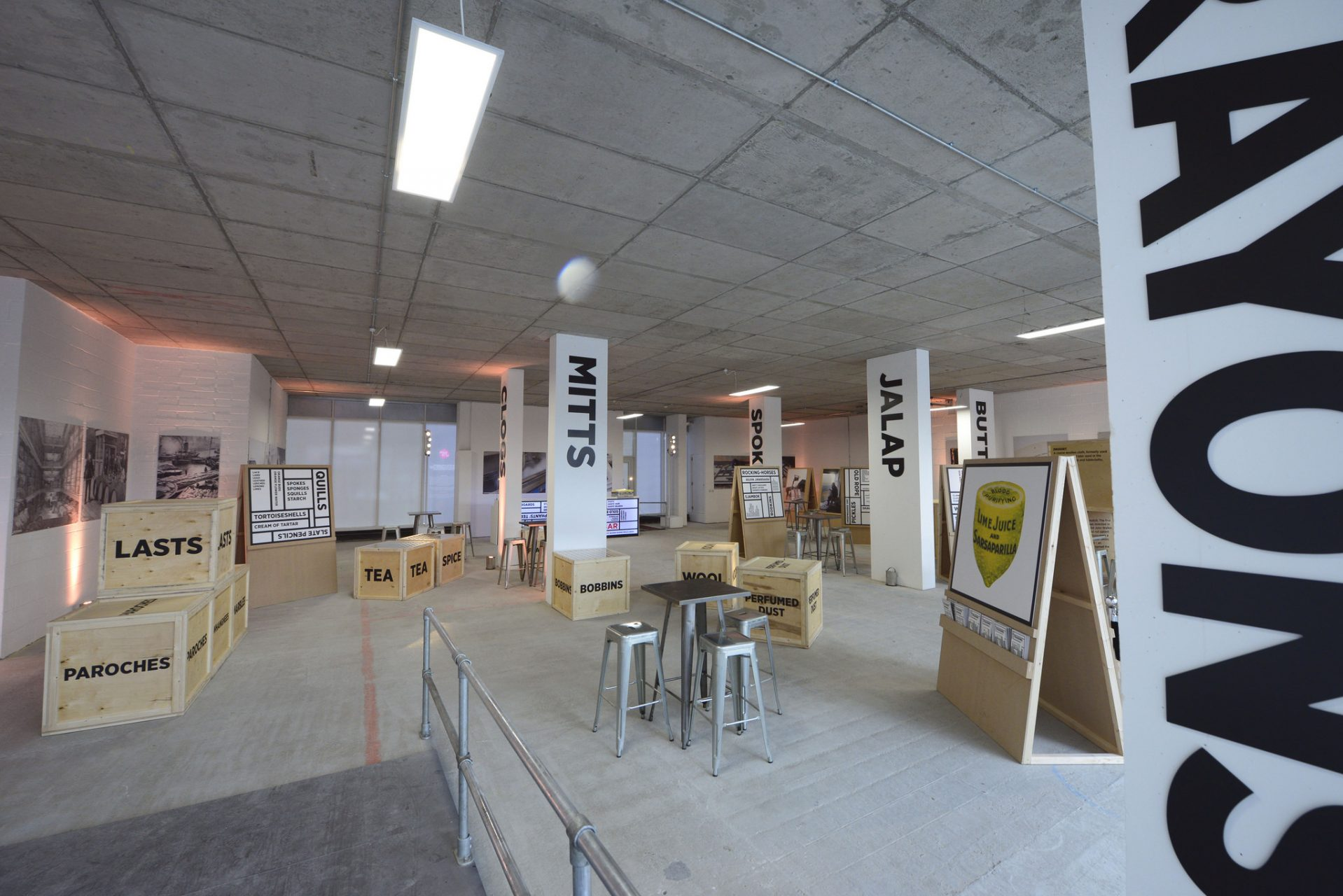 Event space/gallery style fit out using fret-cut stencils on cargo crates for Trading Words by Octink