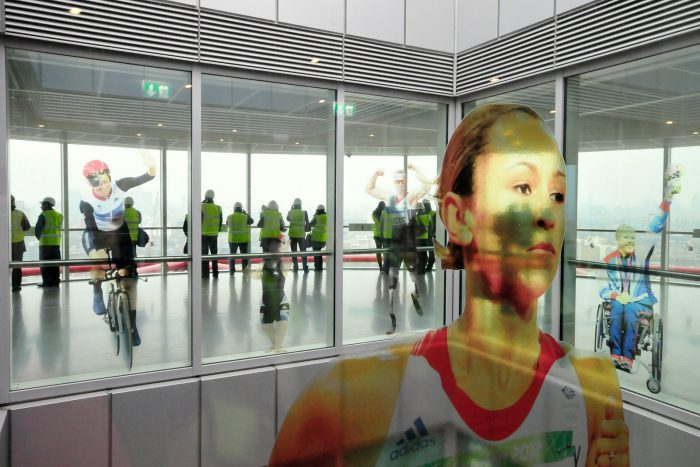 See through Olympic athlete window graphics at Park in Progress by Octink