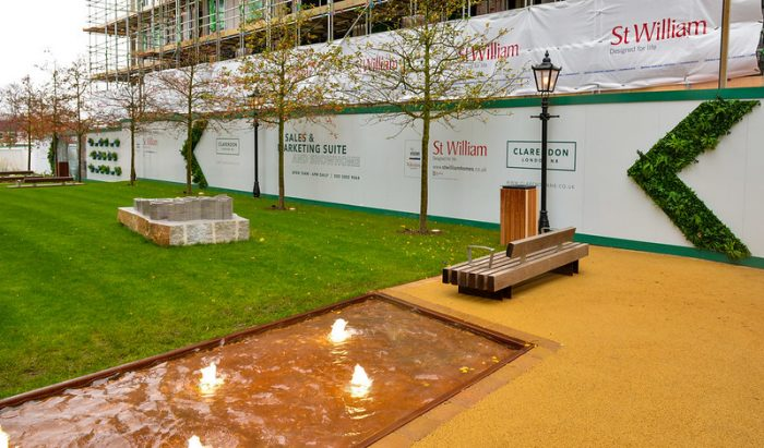 Advertising hoarding with living wall elements by Octink