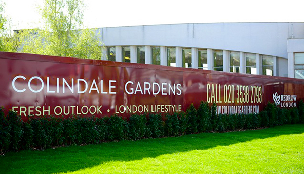 Colour matched red hoarding for colindale