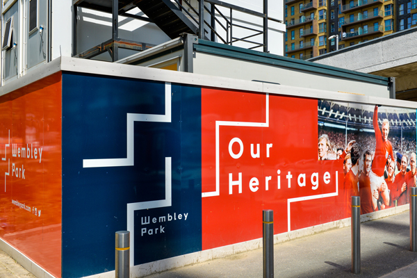 A hoarding in need of a clean in this advertising hoardings FAQ